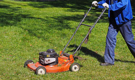 City workers - summer lawn mowing Royalty Free Stock Image