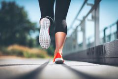 City workout. Woman running in an urban setting Royalty Free Stock Images