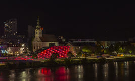 City Workplace in Linz. Night view from the City Workplace situated next to Ars Electronica Center by the shore of the Danube River, Linz, Austria Stock Photography