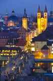 City Wuerzburg. WUERZBURG, GERMANY - OCT 20: the historical skyline and the old stone bridge of medieval city Wuerzburg is romantic illuminated at night on Royalty Free Stock Images