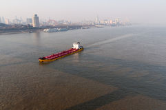 City of Wuhan, China. Wuhan, China - January 25 2012: three town District view from Yangtze river bridge high place in city of Wuhan, China royalty free stock photography