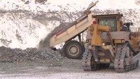 City of Yasny, Orenburg region, Russia, Quarry for the extraction of chrysotile asbestos, 02/10/2018. Work of machinery and machines in the quarry for extraction stock footage