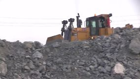 City of Yasny, Orenburg region, Russia, Quarry for the extraction of chrysotile asbestos, 02/10/2018. Work of machinery and machines in the quarry for extraction stock video footage