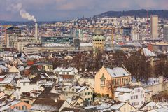 The city of Zurich in Switzerland as seen from the tower of the Grossmunster cathedral in winter. Zurich is the largest city in Switzerland and the capital of royalty free stock image