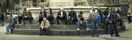 Citylife panorama. People sitting on the steps of a fountain Royalty Free Stock Image