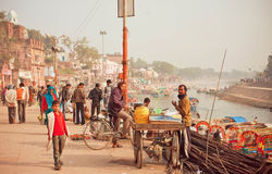 Citylife scene with cyclist and tea masala trader with river behind Royalty Free Stock Images