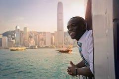 Citylight. Black man enjoying the city view from a ship stock photos