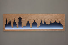 Cityline of Lviv old city carved in wood with light Stock Photos