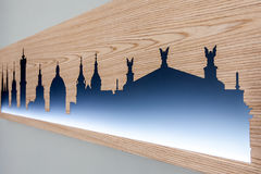 Cityline of Lviv old city carved in wood with light Stock Image