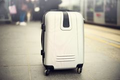 Citypass Light Rail in Jerusalem. Two suitcases standing on railway station against city train. Vacation and travel. Concept. Copy space, selective focus Royalty Free Stock Photo