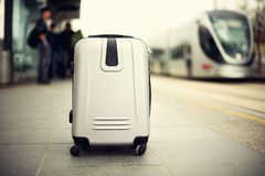 Citypass Light Rail in Jerusalem. Two suitcases standing on railway station against city train. Vacation and travel. Concept. Copy space, selective focus Royalty Free Stock Image