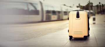 Citypass Light Rail in Jerusalem. Two suitcases standing on railway station against city train. Vacation and travel. Concept. Copy space, selective focus Stock Image