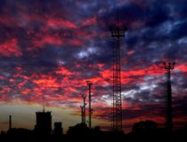 Cityscape. High cell tower silhouettes - sunrise Royalty Free Stock Photos