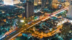 Cityscape aerial view timelapse at night bangkok, Busy traffic across main road at rush hour thailand. Beautiful architecture And a new perspective stock video