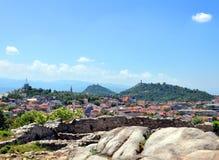 Cityscape against mountain range Royalty Free Stock Photo
