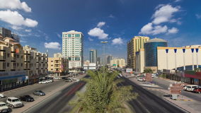 Cityscape of Ajman from bridge at day timelapse. Cityscape of Ajman with traffic on road from bridge at day with palms timelapse. Ajman is the capital of the stock video