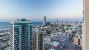 Cityscape of Ajman from rooftop day to night timelapse. Ajman is the capital of the emirate of Ajman in the United Arab Emirates. Cityscape of Ajman from royalty free stock image