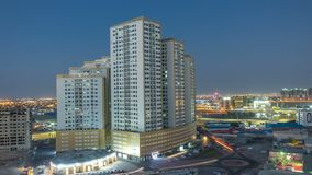 Cityscape of Ajman from rooftop day to night timelapse. Ajman is the capital of the emirate of Ajman in the United Arab Emirates. Cityscape of Ajman from royalty free stock photography