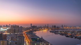 Cityscape of Ajman from rooftop day to night timelapse. Ajman is the capital of the emirate of Ajman in the United Arab stock video footage