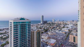 Cityscape of Ajman from rooftop day to night timelapse. Ajman is the capital of the emirate of Ajman in the United Arab stock footage