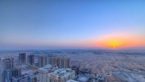 Cityscape of Ajman from rooftop with sunrise timelapse. Ajman is the capital of the emirate of Ajman in the United Arab Emirates. Cityscape of Ajman from royalty free stock images
