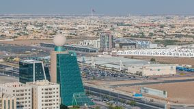 Cityscape of Ajman from rooftop with modern buildings timelapse. Cityscape of Ajman from rooftop with modern buildings and traffic timelapse. Ajman is the royalty free stock photo