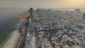 Cityscape of Ajman from rooftop morning after sunrise timelapse. Ajman is the capital of the emirate of Ajman in the United Arab E. Mirates. 4K royalty free stock image