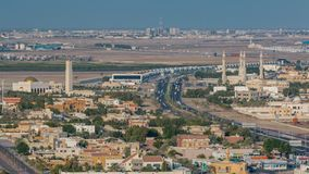 Cityscape of Ajman from rooftop with mosque timelapse. Cityscape of Ajman from rooftop with mosque and traffic timelapse. Ajman is the capital of the emirate of stock photos