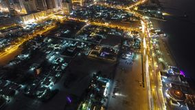 Cityscape of Ajman from rooftop at night timelapse. Ajman is the capital of the emirate of Ajman in the United Arab Emirates. Panoramic Cityscape of Ajman with stock photos