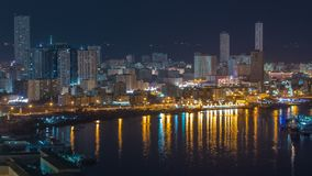 Cityscape of Ajman from rooftop at night timelapse. Ajman is the capital of the emirate of Ajman in the United Arab Emirates. Cityscape of Ajman from rooftop at stock photo