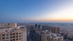Cityscape of Ajman from rooftop night to day timelapse. Ajman is the capital of the emirate of Ajman in the United Arab stock video footage