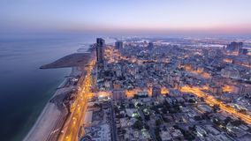 Cityscape of Ajman from rooftop night to day timelapse. Ajman is the capital of the emirate of Ajman in the United Arab Emirates. Cityscape of Ajman from royalty free stock images