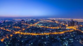Cityscape of Ajman from rooftop night to day timelapse. Ajman is the capital of the emirate of Ajman in the United Arab Emirates. Cityscape of Ajman from royalty free stock photos