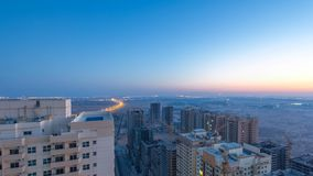 Cityscape of Ajman from rooftop night to day timelapse. Ajman is the capital of the emirate of Ajman in the United Arab Emirates. royalty free stock photos