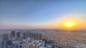 Cityscape of Ajman from rooftop with sunrise timelapse. Ajman is the capital of the emirate of Ajman in the United Arab. Cityscape of Ajman from rooftop fwith stock footage