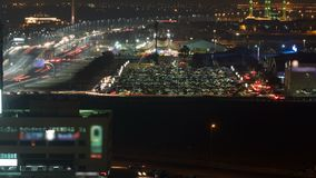 Cityscape of Ajman from rooftop at night timelapse. Ajman is the capital of the emirate of Ajman in the United Arab Emirates. Cityscape of Ajman with traffic on royalty free stock images