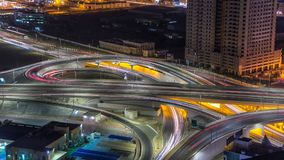 Cityscape of Ajman from rooftop at night timelapse. Ajman is the capital of the emirate of Ajman in the United Arab Emirates. Cityscape of Ajman with traffic on stock image