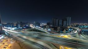 Cityscape of Ajman from rooftop at night timelapse. Ajman is the capital of the emirate of Ajman in the United Arab Emirates. Cityscape of Ajman with traffic on stock photo