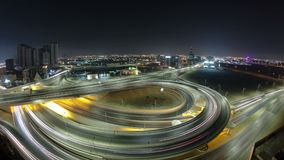 Cityscape of Ajman from rooftop at night timelapse. Ajman is the capital of the emirate of Ajman in the United Arab Emirates. Cityscape of Ajman with traffic on royalty free stock photo