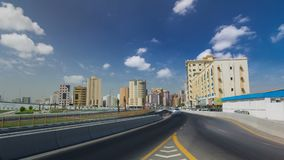 Cityscape of Ajman from bridge at day timelapse. Ajman is the capital of the emirate of Ajman in the United Arab Emirates. Cityscape of Ajman with traffic on royalty free stock images