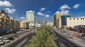 Cityscape of Ajman from bridge at day timelapse. Ajman is the capital of the emirate of Ajman in the United Arab Emirates. Cityscape of Ajman with traffic on stock images