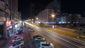 Cityscape of Ajman from bridge at night timelapse. Ajman is the capital of the emirate of Ajman in the United Arab Emirates. Cityscape of Ajman with traffic on stock photo