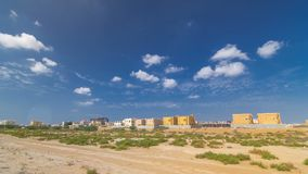 Cityscape of Ajman with villas ready and under constroction timelapse. Ajman is the capital of the emirate of Ajman in the United. Arab Emirates. 4K royalty free stock images