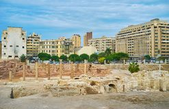 Roman Auditorium and thermae, Kom Ad Dikka archaeological site,. The cityscape of Alexandria with antique ruins of Roman auditorium lecture hall and thermae royalty free stock photos