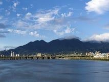 Cityscape along river Stock Image