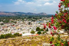 Cityscape of ancient Archangelos scenic old town with castle on Rhodes island, Dodecanese, Greece. Beautiful picturesque white. Houses with flowers. Famous royalty free stock image