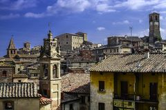 A cityscape of Anghiari a closer look with a cloudy sky. A cityscape of Anghiari with a cloudy sky. A closer look of the roofs of the ancient village royalty free stock photography