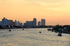 Cityscape of Asiatique the Riverfront is popular and famous place in the evening with sunset time at Bangkok, Thailand. stock photo