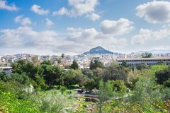 Cityscape of Athens with Lycabettus Hill Stock Images
