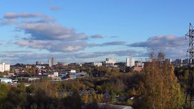 Cityscape in autumn view from hill stock video